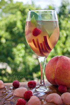 How to Make White Peach Sangria Recipe with white wine, peach simple syrup, St. Peach Sangria Recipes, White Peach Sangria, Cocktail Recipes, Cocktails, Alcoholic Drinks, Beverages, Summertime Drinks, Simple Syrup, White Wine