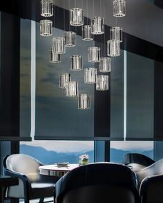 Cluster lights are everywhere this year. Ths rather sophisticated one is made forrom clear glass and steel