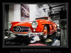 """""""Elevated Excellence""""--300SL """"Gulwing"""" on lift, being prepped for Pebble Beach at Mercedes-Benz Classic Center, USA"""