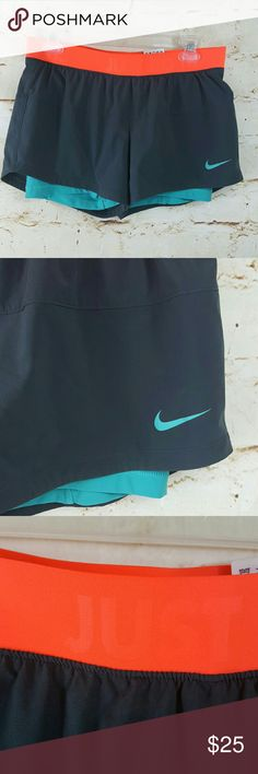 Nike Dri fit shorts with compression shorts under Excellent condition like new Nike Dri fit running shorts with compression shorts underneath. Wide waistband for comfort Nike dri fit technology keeps you dry. Nike Shorts
