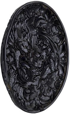 Dish, carved black lacquer, China, Yuan dynasty, ca.1300-1350. Diameter: 31.8 cm. FE.20:1, 2-1974. Given by Sir Harry and Lady Garner. © V Images.