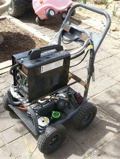Welding cart made from a garden hose holder. By JR