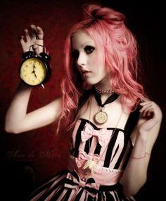 Pink hair , corset (black & pink striped corset) , background + old clock / watch . Kinda Emilie Autumn -like.