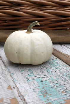 .Love the vintage board.  Have off white pumpkins, can paint and distress board.