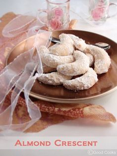Almond crescent cookies - taste and texture is similar to Armenian Kourabia cookies. Festive at Christmas. Greeks, Persians and Lebanese have similar cookies.