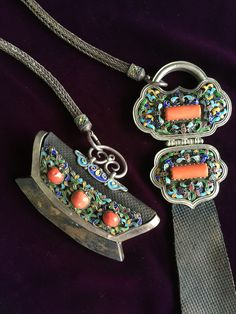 A set of tinder pouch/striker and belt pendant. Enamelled silver, inset coral, leather and silver chain. Mongolian, 19th c