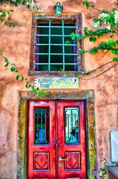 Wine bar in Oia, Santorini, Greece by George Leontaras