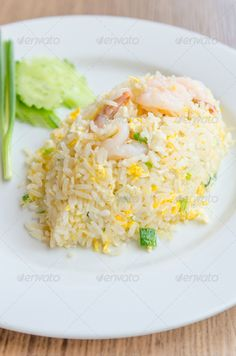 Fried thai rice ...  asian, background, chicken, cook, cooking, cuisine, delicious, dinner, dish, egg, food, fried, fry, gourmet, isolated, lunch, restaurant, rice, shrimp, style, thai, thailand, tomato, vegetable, white