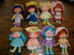 group of vintage strawberry shortcake dolls