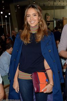 Casual chic: The 35-year-old starwore a navy blue turtleneck featuring a multi-coloured stripe design around her neck and along the bottom of the garment
