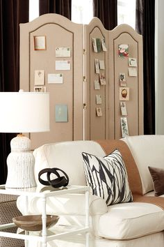Bunny Williams' upholstered screen in a cozy, family room