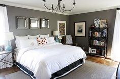 Love the color of the room and the mirrors above the bed.
