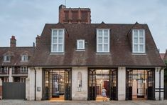 Architecture office Tate Harmer has converted a 100-year-old fire station in Belsize Park, London, into a set of apartments.
