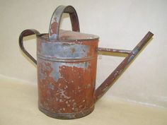 Vintage Watering Can with paint loss...