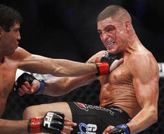 Gilbert Melendez (left) fights against Diego Sanchez in their lightweight bout during UFC 166 at Toyota Center in Houston, USA Andrew Richardson/USA Today Sports