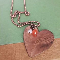 A personal favorite from my Etsy shop https://www.etsy.com/listing/466883624/vintage-copper-heart-necklace
