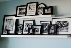 gallery wall w/two sizes of shelves; love the monogram print!