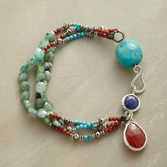 """JEWELRY BOX BRACELET -- As if plucked from the jewelry box, emeralds, turquoise, red jasper and pyrite circle around a three-strand bracelet holding faceted sapphire and carnelian framed in sterling silver. Sterling hook. Exclusive. 7-1/2""""L."""