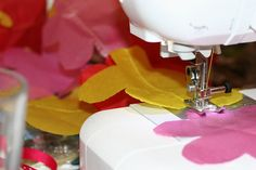 DIY Tissue Garland | Pretty Prudent used tissue paper shapes and sewed a garland together.  If all went well, this could be a fast way to make them.   Nice job giving specific instructions.