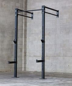 The American Made Wall-Mounted Rig by Bomb Proof is designed for both weight training and bodyweight training. Its heavy-duty frame is fabricated from 3 x 3 x 11 gauge steel tubing that is connected by diameter single and double bar connect Crossfit Garage Gym, Home Gym Garage, Crossfit At Home, Home Made Gym, Diy Home Gym, Gym Room At Home, Homemade Gym Equipment, Diy Gym Equipment, Gym Rack