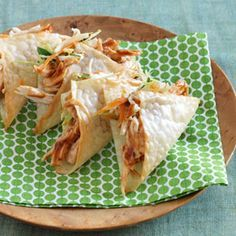 Wonton tacos: Nonstick cooking spray  8 wonton wrappers  4 ounces cooked, shredded skinless chicken breast (1 cup)  2 tablespoons barbecue sauce  3/4 cup packaged coleslaw mix  2 tablespoons low-fat sesame ginger dressing  2 tablespoons chopped fresh cilantro
