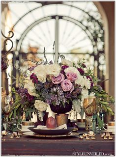 Tuscany Inspired Wedding Flowers. I like the muted colors and gold accents.