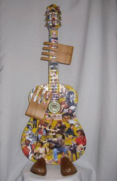 Guitar Heroes ... found object guitar assemblage by Roberta Karstetter