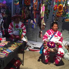 #hollywoodforevercemetery #diadelosmuertos Two Huichol artisans wearing traditional clothing surrounded by their art and crafts #artehuichol