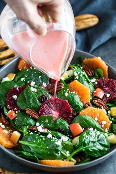 Apple Citrus Spinach Salad with Blood Orange Dressing aka my new favorite way to faceplant into a bag of spinach! This speedy spinach salad is spiked withfruit, nuts, and cheese then topped with the most delicioushomemade dressing!