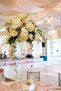 Centerpiece full of orchids, peonies, and hydrangeas: http://www.stylemepretty.com/south-carolina-weddings/charleston/2014/10/07/elegant-ballroom-wedding-in-charleston/ | Photography: Marni Rothschild - http://www.marnipictures.com/