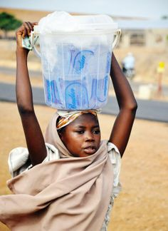Girl with water bags Photo by Jakub Durovsky -- National Geographic Your Shot