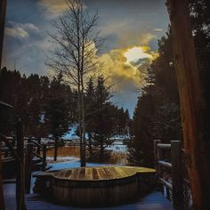 Sunset and silhouettes over the cedar soaking tub at Trapper Cabin. Glamping nights are never lonely with the trees, stars and birds as our constant companions.   Photo by Assistant Housekeeping Manager Chrissy Gursky