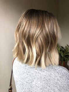 This beach and rooty blonde was created with balayage and baby fine highlights aka babylights. I also gave her this beautiful textured lob haircut with completed the whole look. Get your blonde haircolor or lob haircut by booking with me at my salon! Blonde Balayage Bob, Brown Blonde Hair, Short Hair With Balayage, Lob Ombre, Blonde Lob Hair, Bronde Lob, Short Blonde Haircuts, Blonde Honey, Honey Balayage