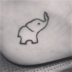 tiny elephant tattoo
