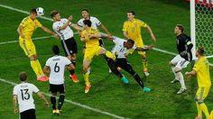 Khacheridi heads at goal.