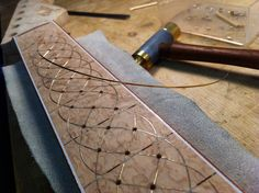 Pine Cone Stratocaster neck. Finishing 18k  gold wire inlay on the neck. Holes will be set with diamonds.