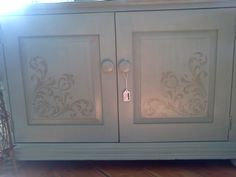 April James / Annie Sloan Chalk Paint wins again against a boring piece of furniture.  This time we added a stenciled design on the doors.