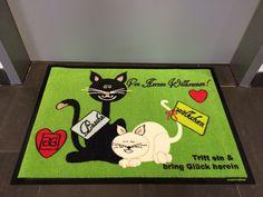 Fußmatten-Design mit Katzen.