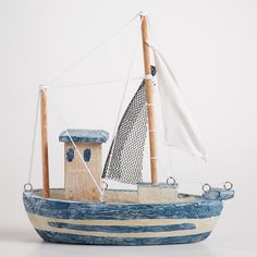 One of my favorite discoveries at WorldMarket.com: Wood Fishing Boat Decor