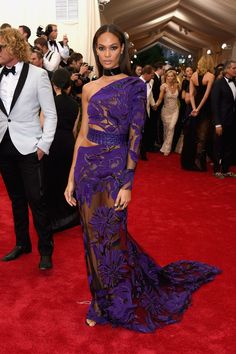 Joan Smalls in a Roberto Cavalli dress and Lynn Ban jewelry