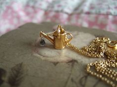 My watering can necklace by Alex Monroe