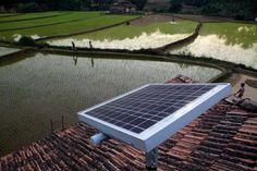 A solar panel stands on the roof of a house in Halliberu, India on January 11, 2012. Across India and Africa, startups and mobile phone companies are developing so-called microgrids, in which stand-alone generators power clusters of homes and businesses in places where electric utilities have never operated. (Kuni Takahashi/Bloomberg) #