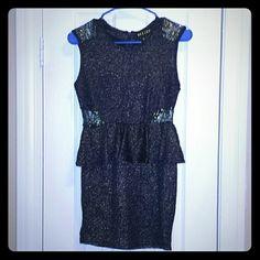 Velzer peplum club dress Dark blue shiny club dress by Velzer. Peplum skirt style. Has no zippers, just a slip on. Velzer Dresses