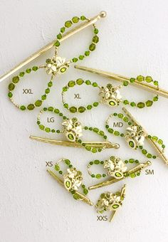 Lilla Rose Inc - Lovely brass and olivine combined for an admirable balance of beauty and strength. Limited Edition.    Download the  Consultant Marketing Pack  for this product.