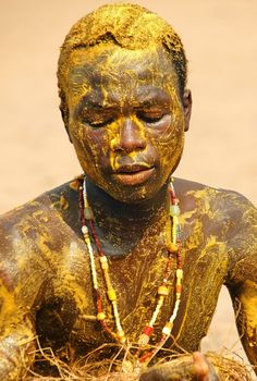 Africa |'The Ban of Kokou'. A Yoruba tribesman dances in trace to the Drums that Kokou, the most feared Yoruba god of warriors, evokes. He is smeared with a mixture of corn flour and plam oil, which pleases the gods. Coastal Benin | ©Corrie de Winter