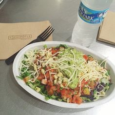 Trying to keep it healthy on the go while traveling!  I get the salad bowl with chicken, black beans, corn salsa, extra tomatoes, easy cheese and try my best not to inhale all the guacamole they put on it  #chipotle #honeybeehealth