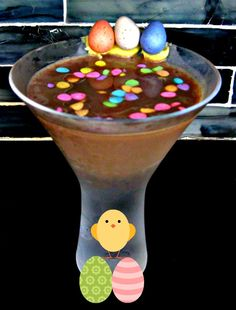 Cadbury Mini Egg Martini 1.5 ounces Adult Chocolate Milk [substitute: Godiva Chocolate Liqueur] 1.5 ounces Smirnoff Fluffed Marshmallow Vodka 1 ounce Godiva White Chocolate Liqueur .5 ounce Creme de Cacao few squeezes chocolate syrup  Using some frosting, apply a few Cadbury mini eggs to the side of your glass and place in the freezer.  Add lots of ice to your shaker. Add all ingredients, and shake vigorously. Remove glass from freezer and strain into the chilled glass.