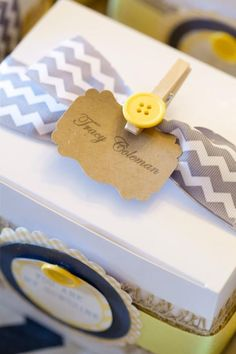 "use clothespin to attach ""bundle of joy"" tag to socks/mittens"
