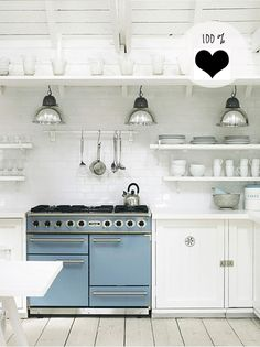 open shelves over subway tiles