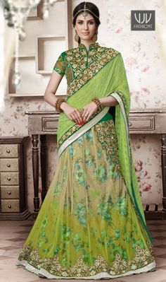 Arresting Net Embroidered Work A Line Lehenga Choli Add grace and charm towards the look in this desirable green net a line lehenga choli. This attractive attire is displaying some brilliant embroidery done with embroidered, patch border and resham work. Comes with matching blouse.